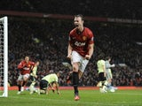 Man Utd defender Jonny Evans celebrates his equaliser against Newcastle on December 26, 2012