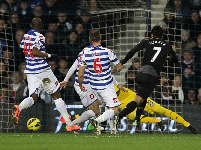 Luis Suarez scores the opener against QPR on December 30, 2012