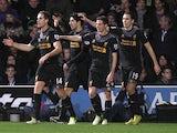 Luis Suarez celebrates his goal with team mates against QPR on December 30, 2012