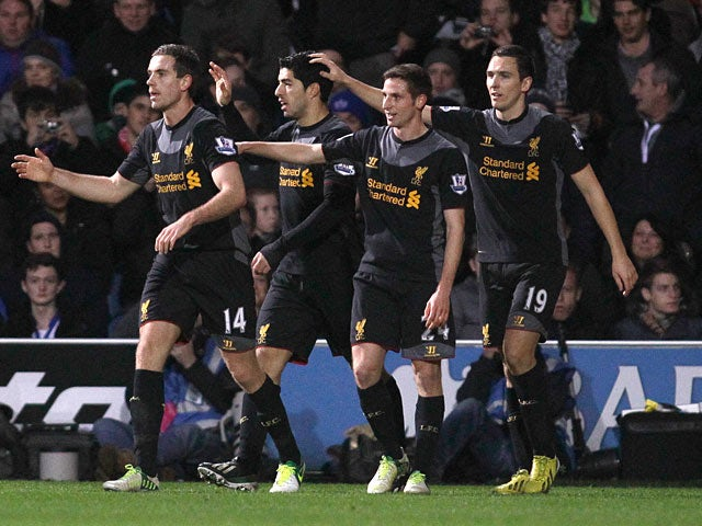 Luis Suarez celebrates his goal with team mates against QPR on December 30, 2012