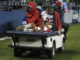 San Fran receiver Mario Manningham is removed from the field after injuring his knee against Seattle on December 23, 2012