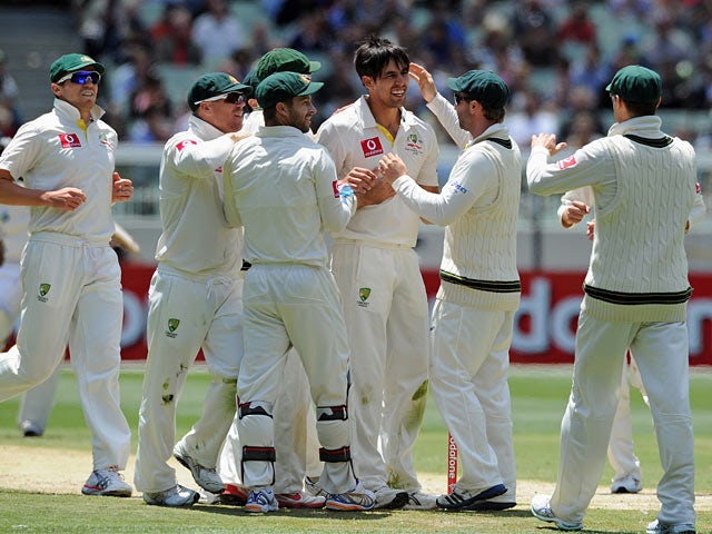 Australia's Mitchell Johnson is congratulated by his team after bowling out Sri Lanka's Angleo Mathews on December 28, 2012