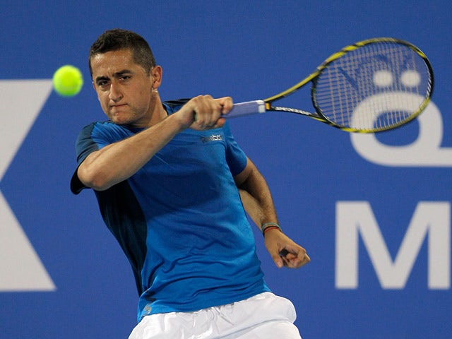 Nicolas Almagro returns the ball during the World Tennis Championship final against Novak Djokovic on December 29, 2012