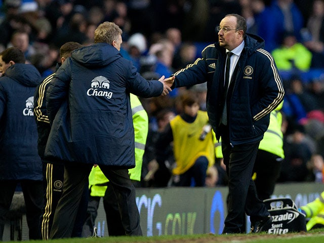 Chelsea interim manager Rafa Benitez and Everton manager David Moyes shakes hands at the end of their match on December 30, 2012