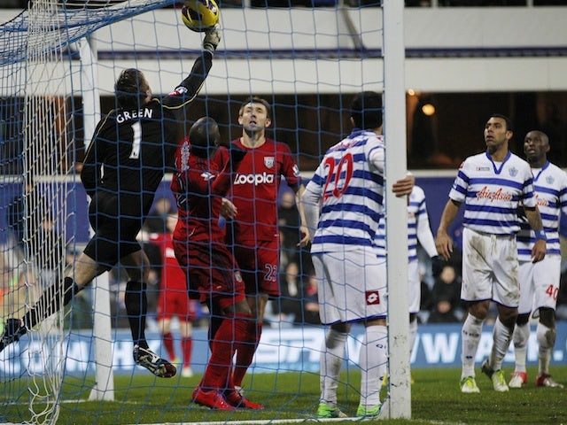QPR keeper Rob Green flicks the ball into his own net against West Brom on December 26, 2012