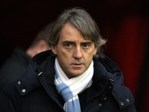 Mancini refuses to give up on title