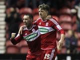Middlebrough's Adam Reach is congratulated by team mate Scott McDonald after scoring his goal on December 29, 2012
