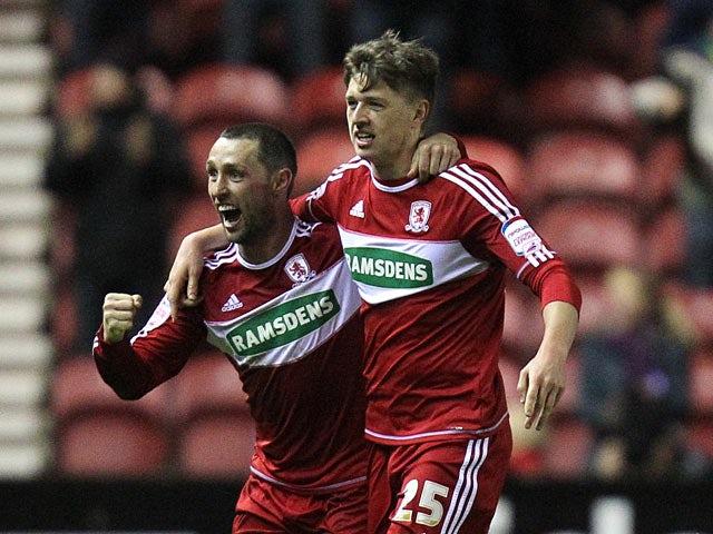 Middlebrough's Adam Reach is congratulated by team mate Scott McDonald after scoring his goal on December 29, 2012