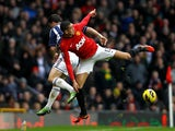Shane Long and Chris Smalling battle for the ball on December 29, 2012