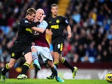 Aston Villa's Stephen Ireland and Wigan's James McCarthy battle for the ball on December 29, 2012