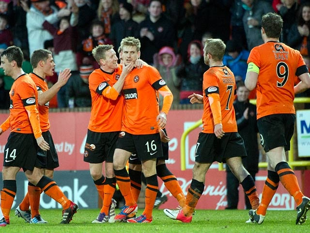 Dundee United's Stuart Armstrong is celebrates with his team mates after scoring against St Mirren on December 30, 2012