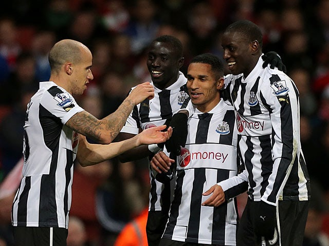 Sylvain Marveaux is congratulated by team mates after scoring his team's second goal against Arsenal on December 29, 2012