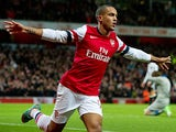 Theo Walcott celebrates scoring the opener against Newcastle on December 29, 2012