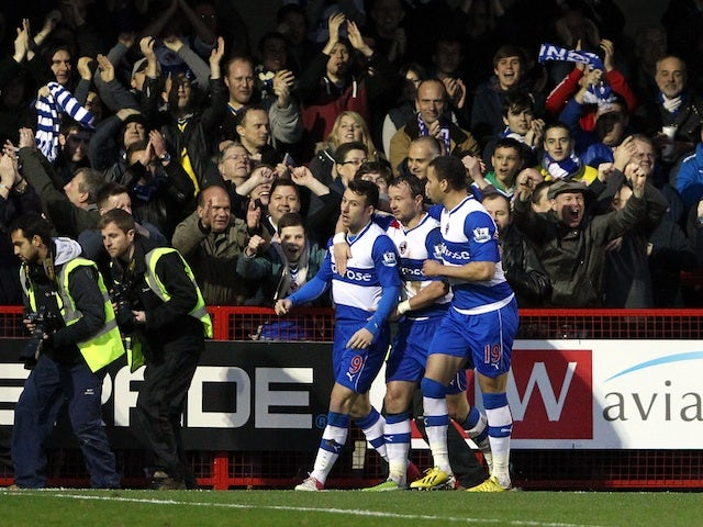 Reading striker Adam Le Fondre is congratulated by teammates following a goal against Crawley on January 5, 2013
