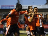 Luton players celebrate Alex Lawless' opener against Wolves in Round 3 on January 5, 2013