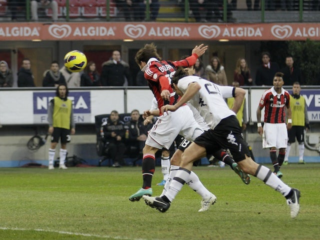 Milan striker Bojan scores a goal against Siena on January 6, 2013