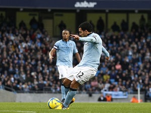 Tevez charged with driving offences