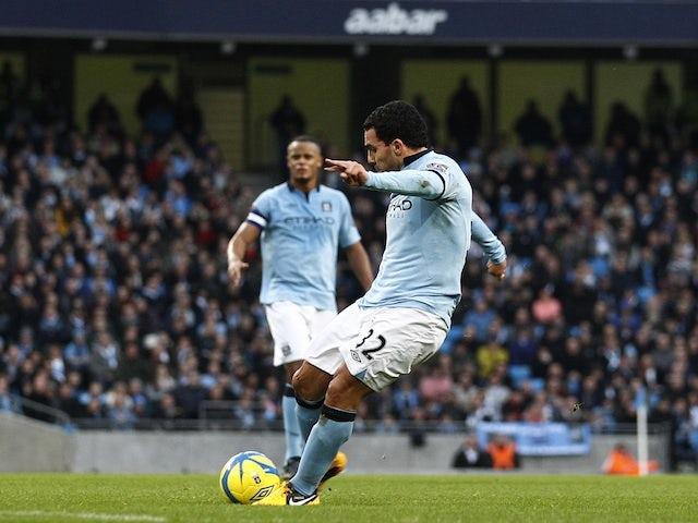 City striker Carlos Tevez fires in the opener against Watford on January 5, 2013