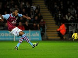 Villa striker Christian Benteke scores a penalty against Swansea on January 1, 2013