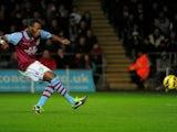 Villa striker Christian Benteke scores a penalty against Swansea on January 1, 2013