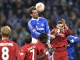 Schalke's Christoph Metzelder heads the ball on December 15, 2012