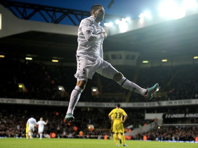 Spurs forward Clint Dempsey celebrates a goal against Reading on January 1, 2013