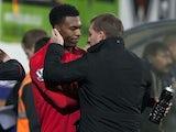 Liverpool boss Brendan Rodgers congratulates Daniel Sturridge following a goalscoring debut at Mansfield on January 6, 2013