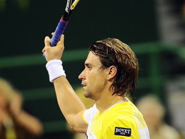David Ferrer celebrates his win over Paolo Lorenzi in the Qatar Open on January 3, 2013