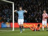 City striker Edin Dzeko celebrates their second goal against Stoke on January 1, 2013