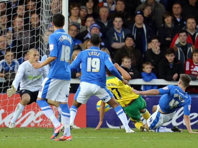 Norwich midfielder Elliott Bennett scores the first goal against Peterborough United on January 5, 2013