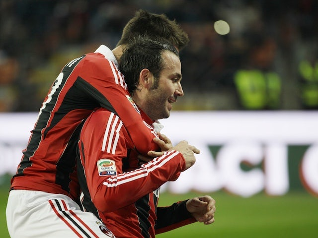 AC Milan's Giampaolo Pazzini celebrates his goal during the 2-1 win over Siena on January 6, 2013