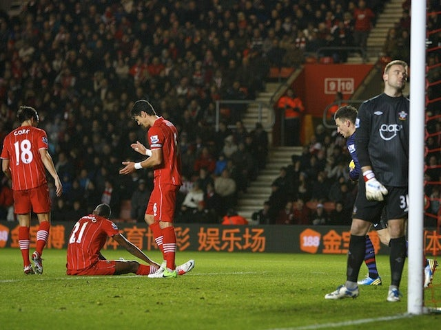 Saints players look dejected following an own goal by Guly Do Prado in the match against Arsenal on January 1, 2013