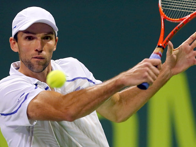 Ivo Karlovic in action against Tomas Berdych during their Qatar Open first round match on December 30, 2013