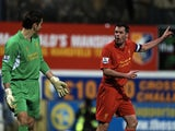 Liverpool's Jamie Carragher barks orders at Brad Jones during a game with Mansfield on January 6, 2013