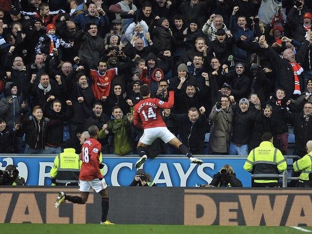 Man Utd forward Javier Hernandez celebrates his opener against Wigan on January 1, 2013