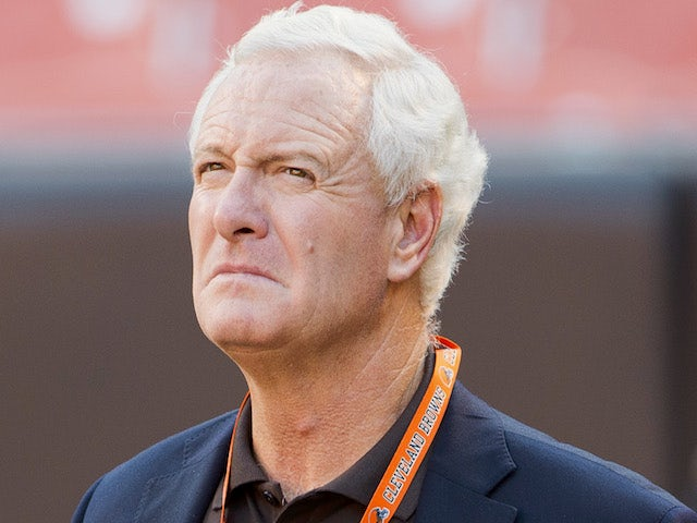 Team owner Jimmy Haslam talk on the field prior to a preseason game of the Cleveland Browns on August 30, 2012