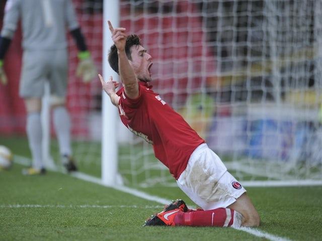 Charlton captain Johnnie Jackson celebrates a goal against Watford on January 1, 2013