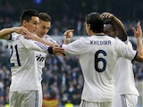 Real Madrid players congratulate Karim Benzema on an early goal against Real Sociedad on January 6, 2013