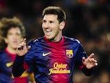 Lionel Messi celebrates Barca's fourth goal against Espanyol on January 6, 2013