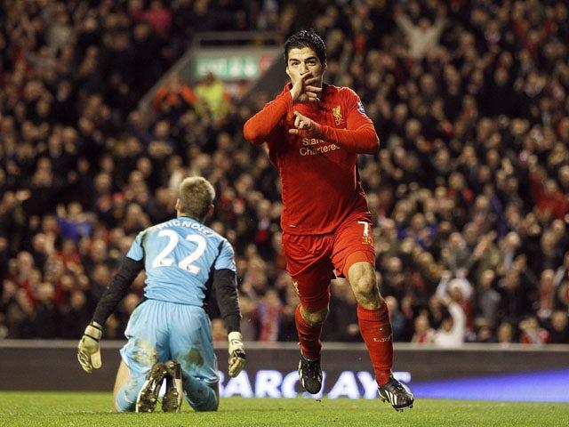 Luis Suarez of Liverpool celebrates scoring his second goal against Sunderland on January 2, 2013
