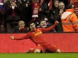 Liverpool striker Luis Suarez celebrates scoring his first goal against Sunderland on January 2, 2013