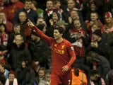 Liverpool's Luis Suarez celebrates scoring his second goal at Anfield during their match against Sunderland on January 2, 2013
