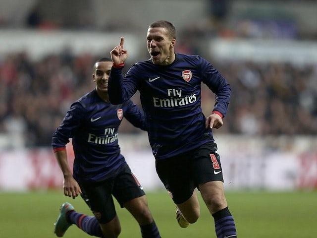 Lukas Podolski celebrates scoring Arsenal's first goal against Swansea on January 6, 2013