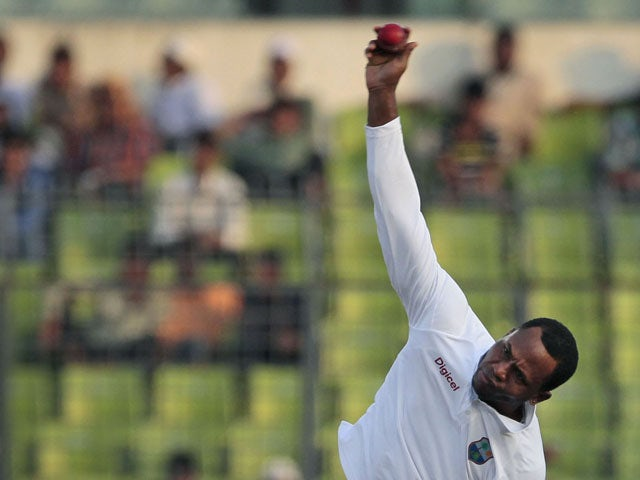 Marlon Samuels bowling for the West Indies on November 15, 2012