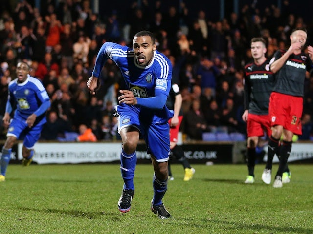 Macclesfield striker Matthew Barnes-Homer celebrates his winning goal against Championship leaders Cardiff on January 5, 2013