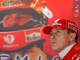 Ferrari's Michael Schumacher in the garage during a practise session of the San Marino F1 Grand Prix on April 23, 2004