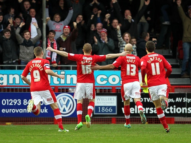 Crawley's Nicky Adams celebrates his goal just 14 seconds into the game with Reading on January 5, 2013