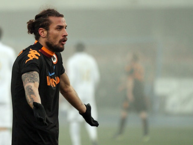 Roma's Pablo Osvaldo appeals a foul against Chievo on December 16, 2012