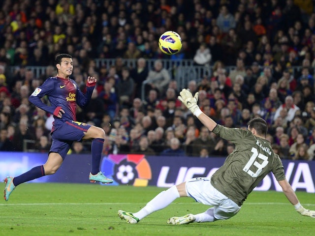 Barca striker Pedro clips the ball in for the third goal against Espanyol on January 6, 2013
