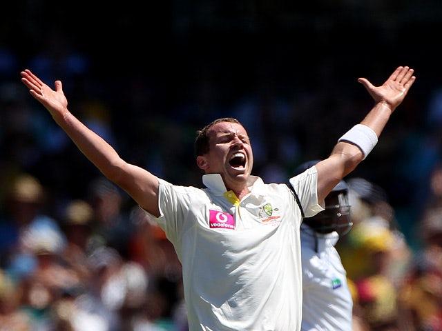 Australia's Peter Siddle celebrates after taking the wicket of Sri Lanka's captain Mahela Jayawardene on January 3, 2013